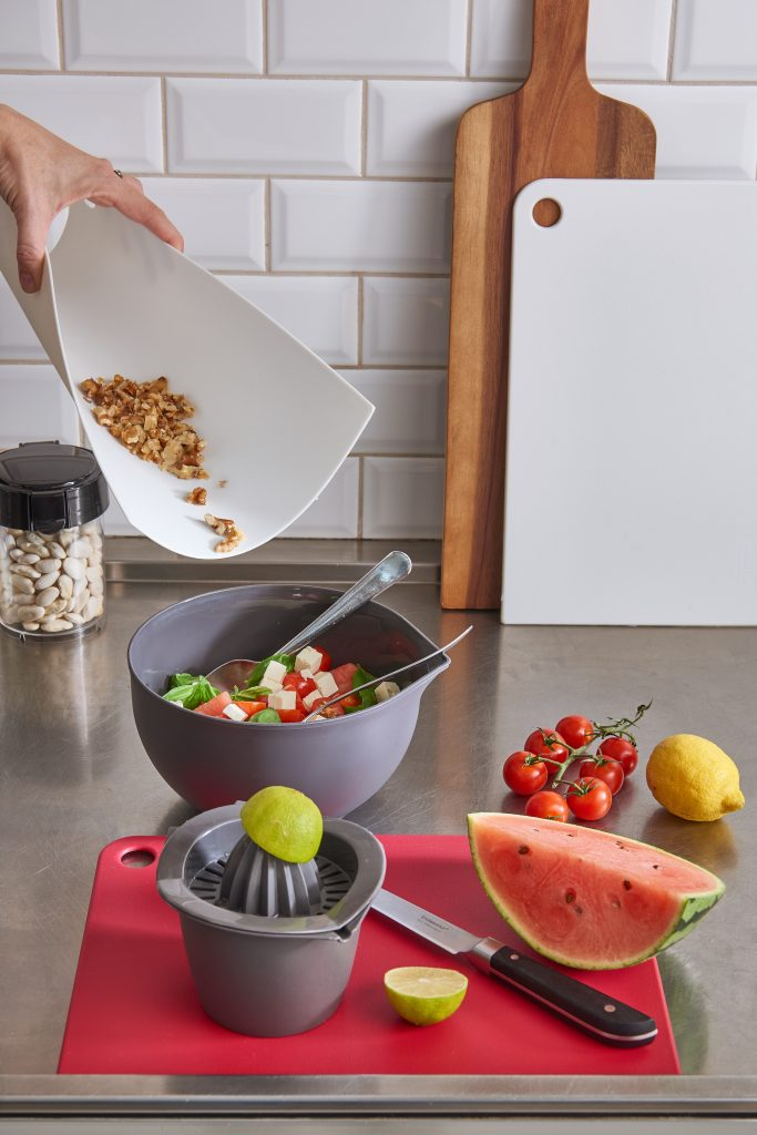 Cutting Board Slim-Line cutting board which is flexible to pour easly and without spilling. It is used during making a salad.