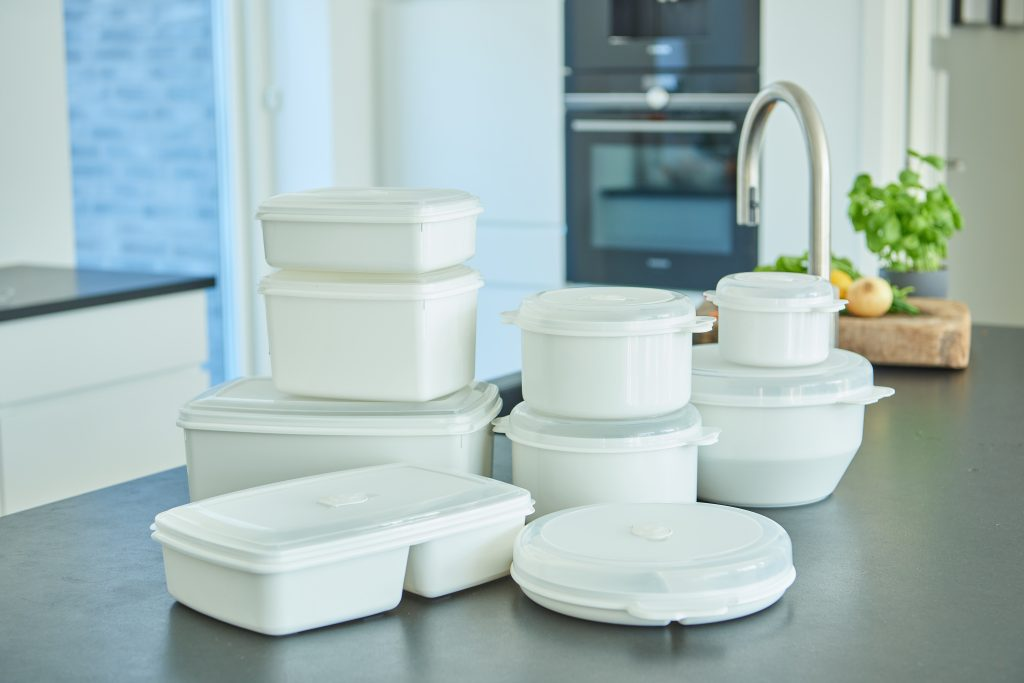 Micro Box series comes in 9 sizes for various needs, including a micro cover to avoid stains. Boxes in white color stand on the table top in a kitchen.