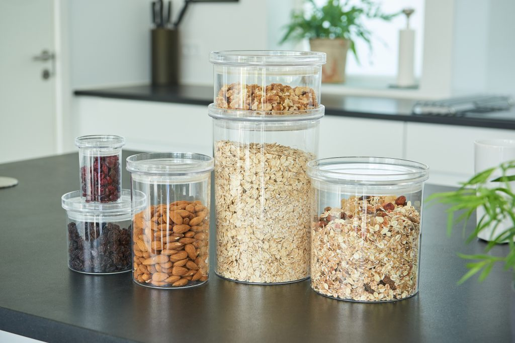 Stockholm, a series of dry food canisters with a classic and clear design. They are stackable for optimal storage. Containers stand on the tabletop.