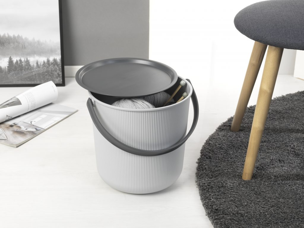 Akita storage bucket is a ideal choice for you crafting or hobby items storage. Bucket stands near the stool in a room.