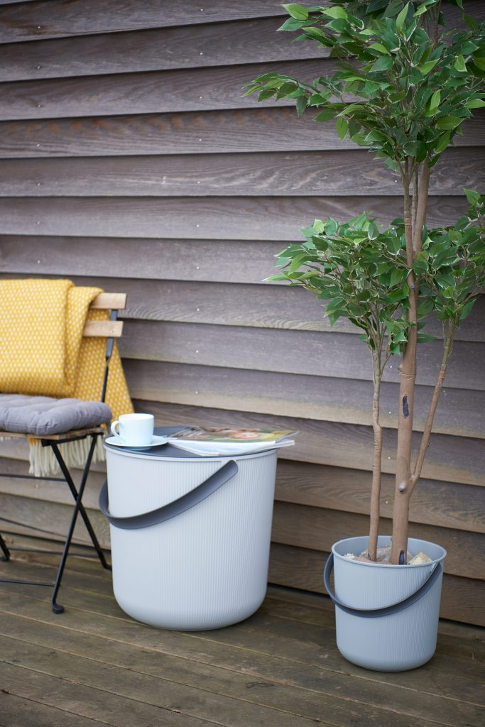Akita storage bucket brings some nature to the home if used as a plant pot. Buckets in two different sizes stands on the terrace.