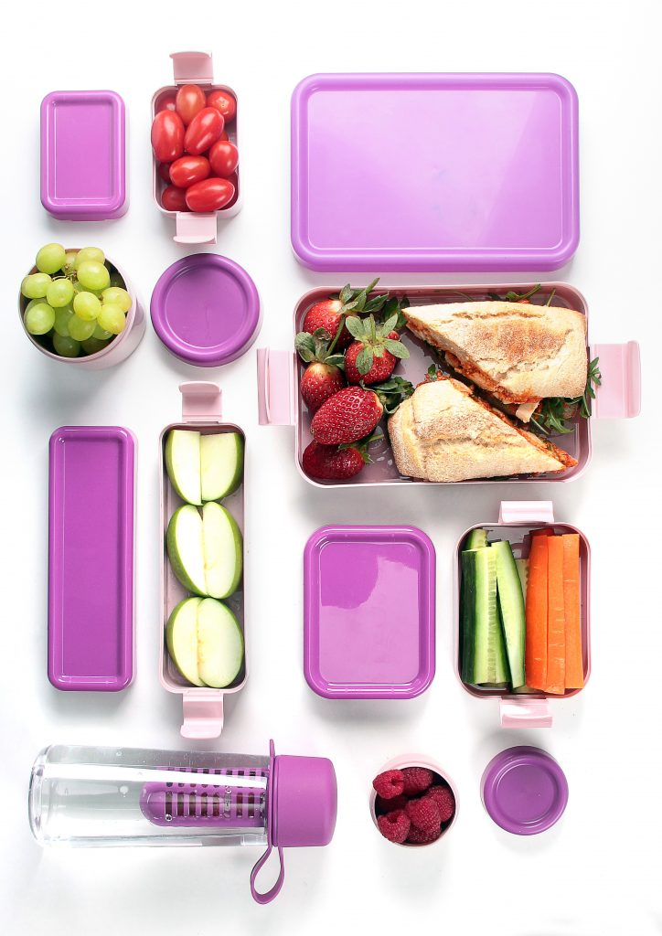 Hilo, series of lunch boxes in various shapes and sizes are prefect for sandwitches, vegatables, fruits or grains. Pink variant of series is presented in an aerial photo.