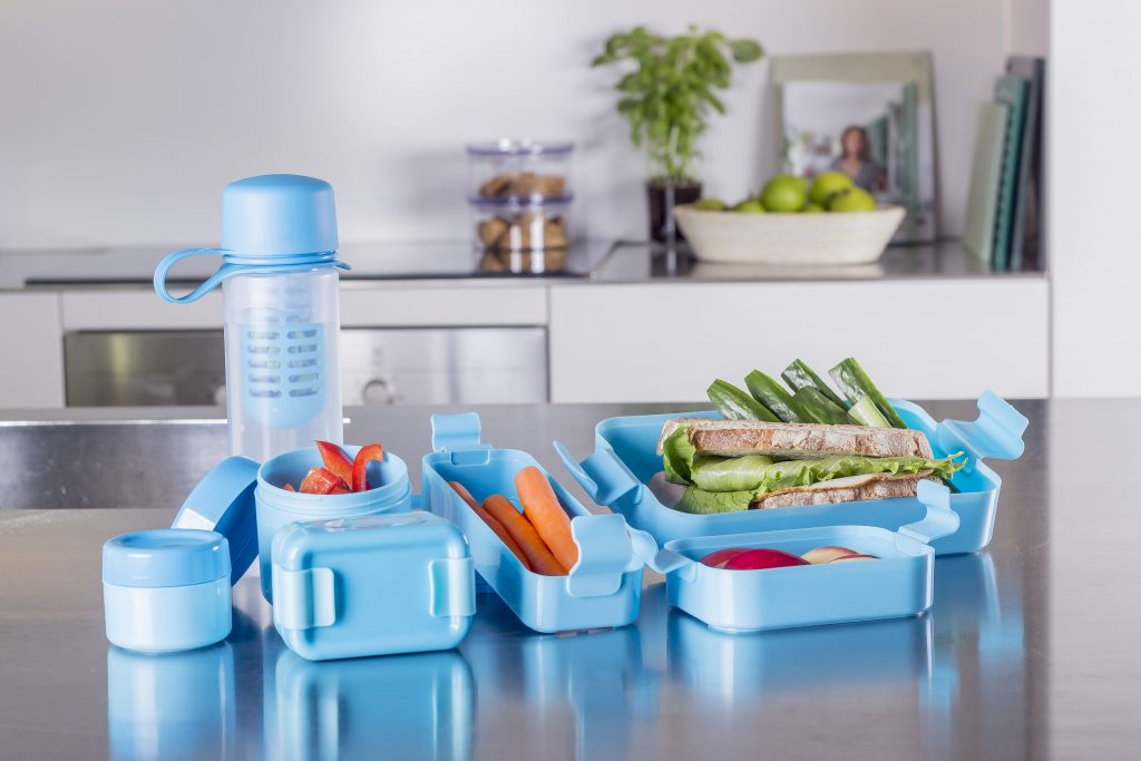Hilo, series of lunch boxes in various shapes including squares, rectangles, and circles. Blue variant of series stands on the tabletop.