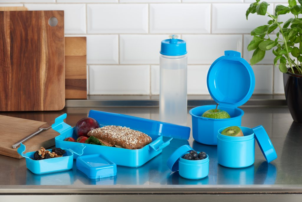 Hilo, series of lunch boxes in various shapes and sizes is suitable for bigger meals as well as smaller snacks. Blue variant of series stands on the tabletop.