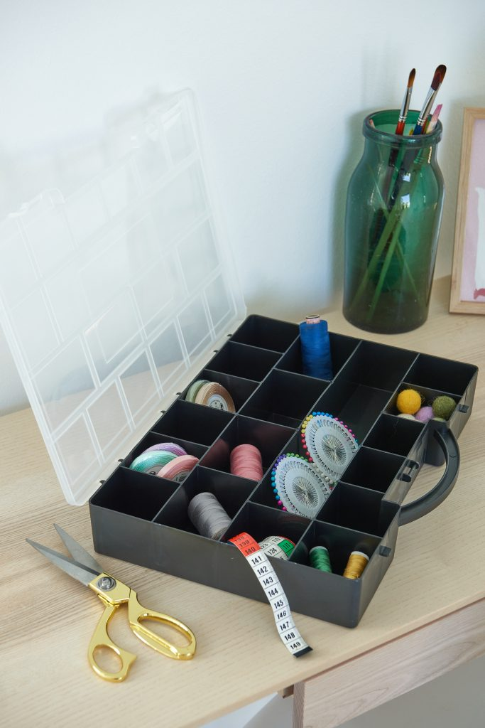 A Hobby Box holder is a convenient solution for storage and transport of sewing or fishing stuff due to the transparent lid and many small rooms inside. The container is opened and placed on the desk.
