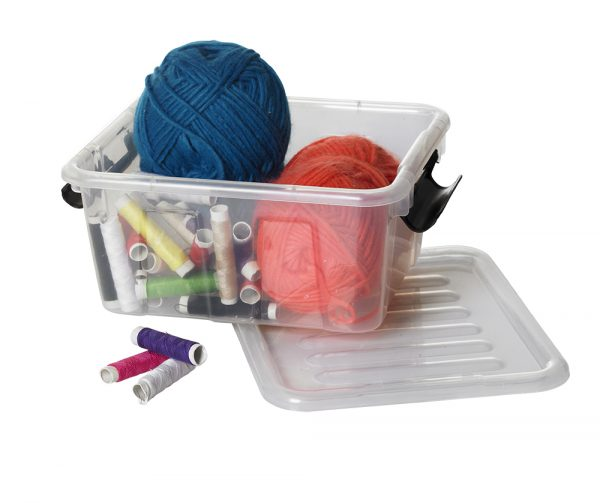 Small Home Box holder suitable to be displayed in any room of your house or office. The storage box is made of clear material and has a clip-closed lid. The container is opened and full of threads and yarn.
