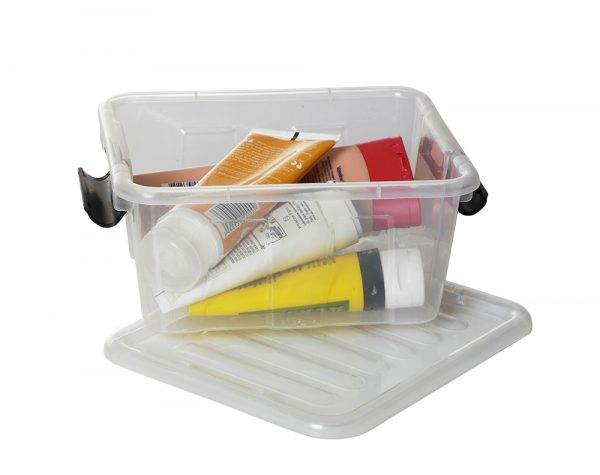 Small Home Box container made of clear material, and with clip-closed lid. The storage box is suitable to be displayed in any room of house or office. The holder is opened and full of cosmetics.