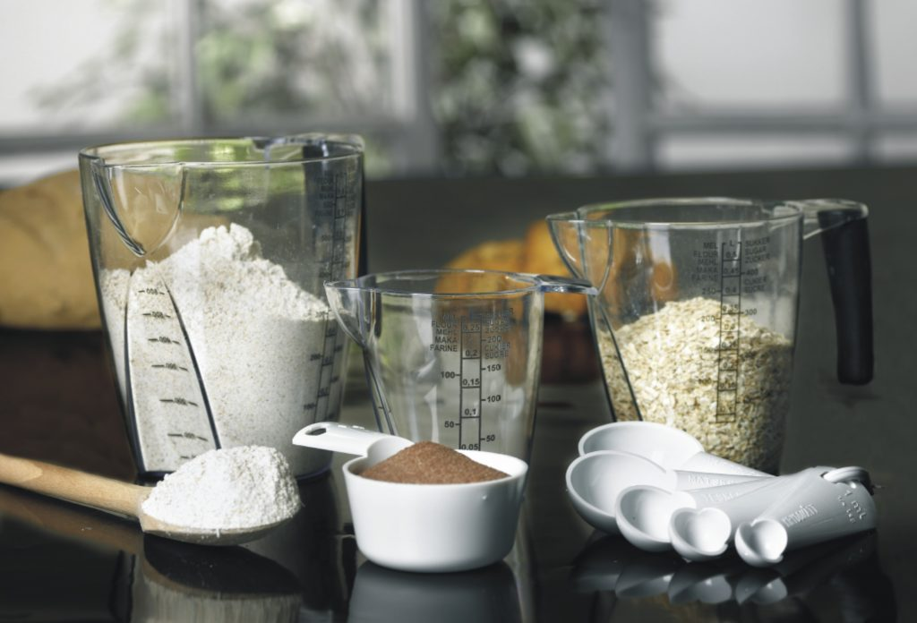 Measuring kitchenware including jugs and spoons in different sizes are ideal to measure almost every type of grocery.