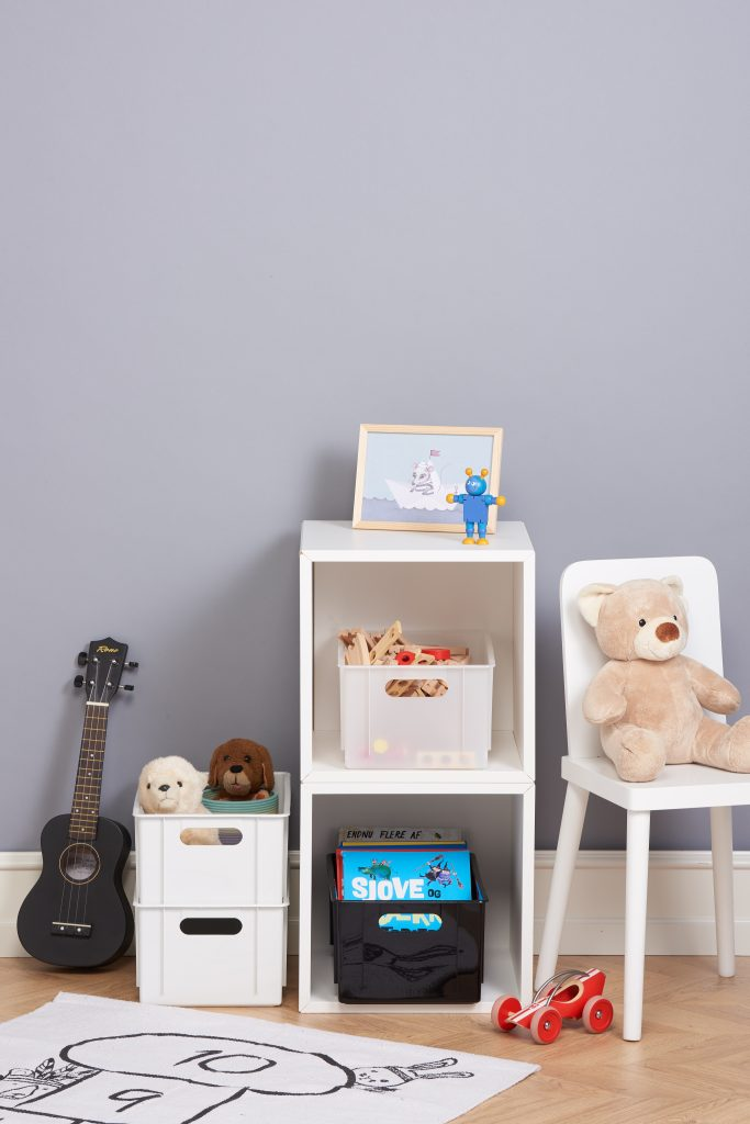 Four Hobby box holders in various colors are the perfect storage solution for schools, homes, and offices. Boxes are placed inside and near the bookcase and used as playroom storage.