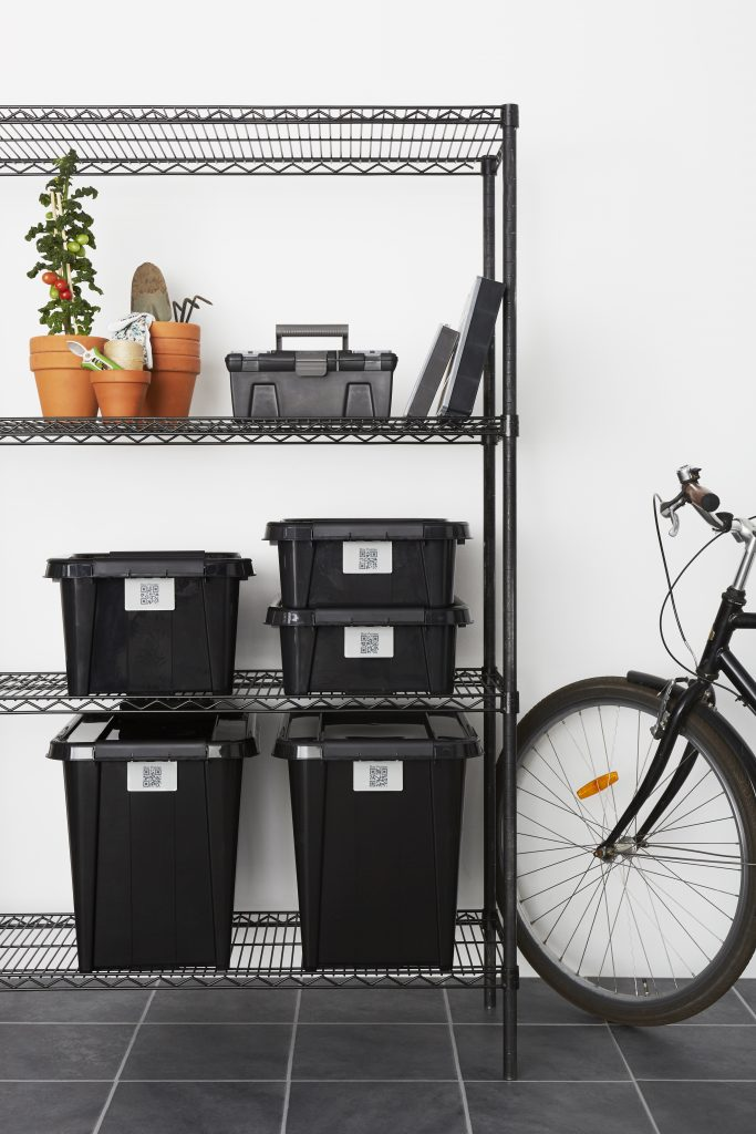 Five stackable Probox Recycle storage boxes made of recycled PP are in three different sizes, equipped with QR codes that help organize your storage. All placed on metal shelves near a bike. Also, Tool Box and Hobby Boxes are visible.