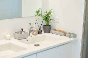A beautiful and elegant Seoul Organizer system in grey color is used as bathroom storage placed around a sink.