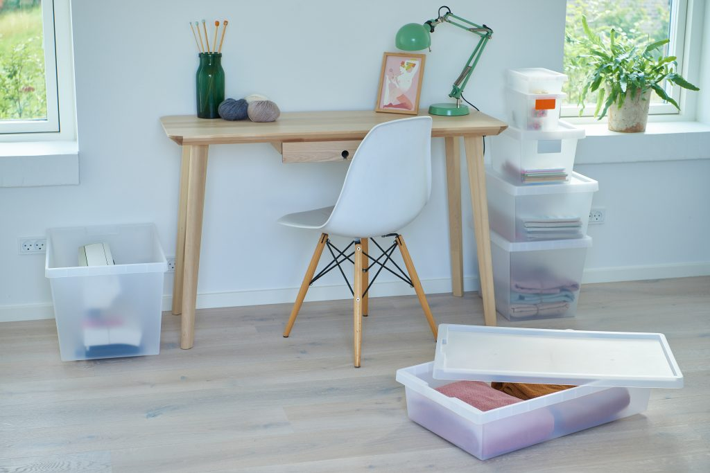 Semi-translucent practical boxes and bed roller, which are part of the Tag Store series are placed around the desk and used as storage for household and office items.
