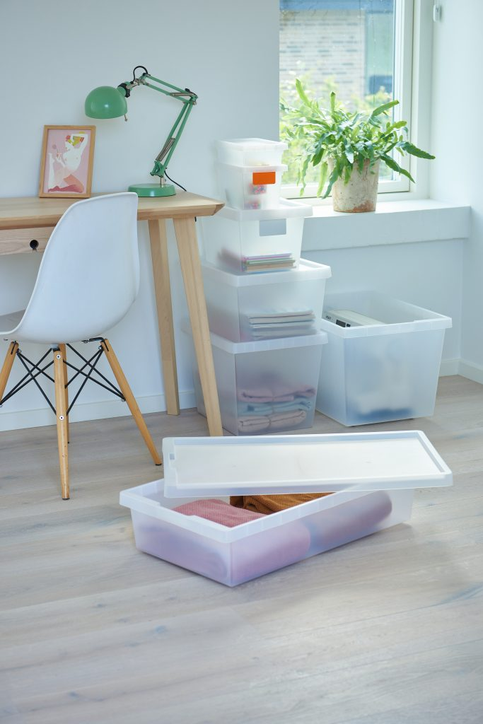Semi-translucent practical boxes and bedroller, which are part of the Tag Store series are placed next to the desk and used as storage for household and office items.