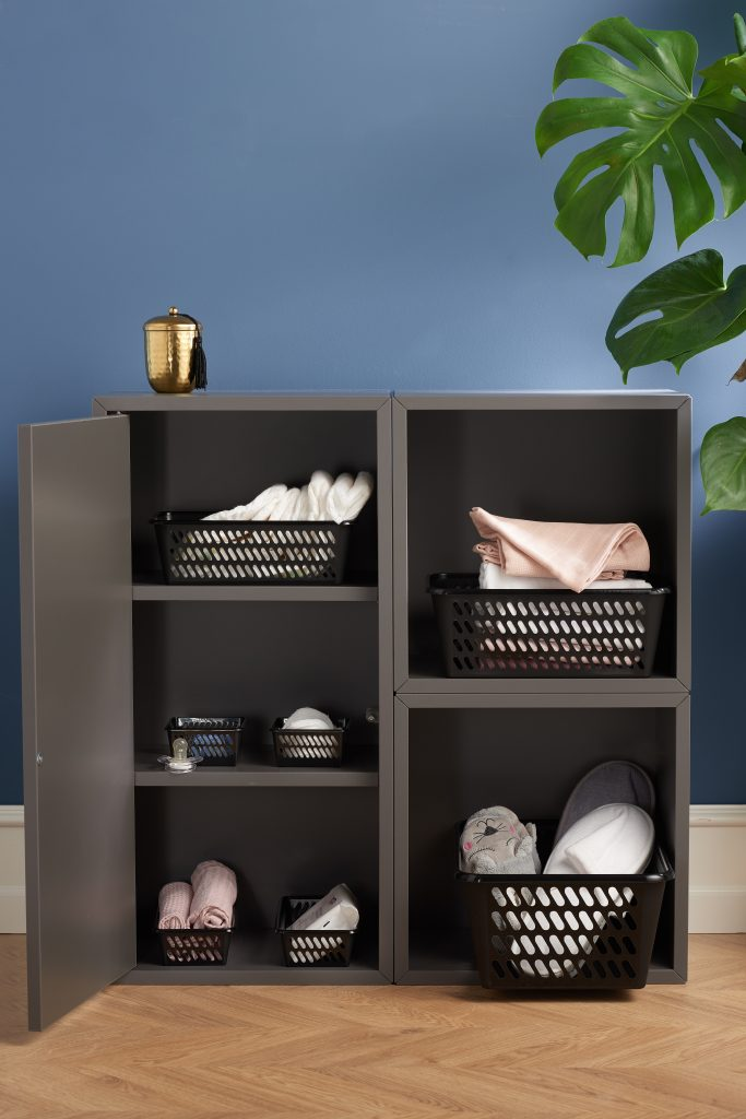 Classic Mini baskets in many various sizes are the perfect living room storage solution. Containers in different sizes are placed inside a cupboard.