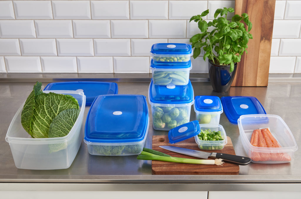 Top Box food storage boxes are avaliable in various sizes and shapes. Also, they are stackable to save space in a fridge. Series of containers stand on the tabletop.